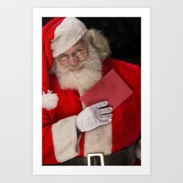 Santa Claus holding a Christmas card close to his heart Art Print