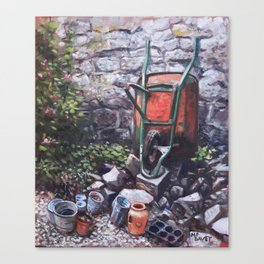 Still life wheelbarrow with collection of pots by stone wall Canvas Print