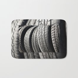 used black tires in row Bath Mat