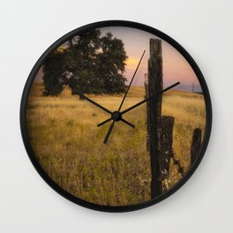 Fenced In an oak tree along the fence at sunset Wall Clock