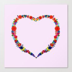 heart made of flowers on a pink background Canvas Print