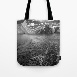 A boat ride in the morning at Milford Sound in black and white Tote Bag