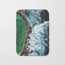 An aerial shot of an ocean rock pool in Bronte beach, Sydney Australia Bath Mat