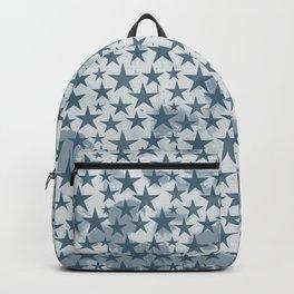 Blue stars on grungey textured white background Backpack