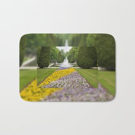 Purple and yellow pansies blooming Bath Mat