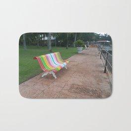 colorful bench sea boardwalk Bath Mat