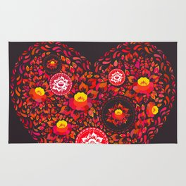 Valentine's Day card Heart made of red orange flowers on black background. Romantic invitation card Rug