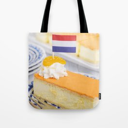 Orange tompouce, traditional Dutch pastry, on a rustic table Tote Bag