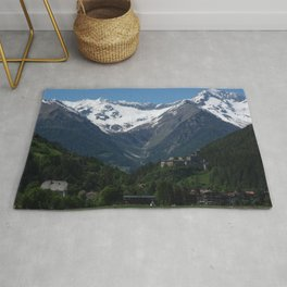 Burg Taufers castle in Val Pusteria. With a snow-covered mountain in background. Italian alps. Sunny spring day. Rug