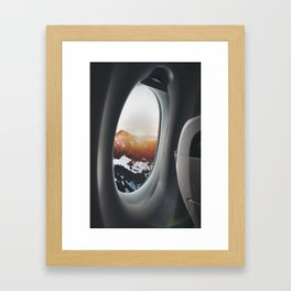 snowy mountains from a plane window Framed Art Print
