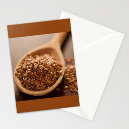 Brown flax seeds heap on wooden spoon Stationery Cards