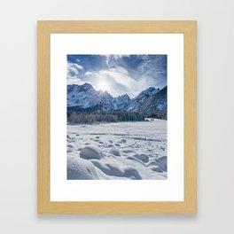 Sunny winter day at snowy frozen lake Fusine Framed Art Print
