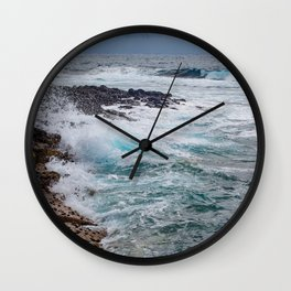 troubled waters rocky shore Wall Clock