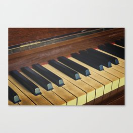 Well worn piano and keys. Canvas Print