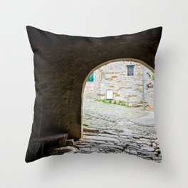 Dark passageway with arch to the light with old paving stone Throw Pillow