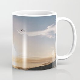 Sunset Paragliding over beach and mountains Coffee Mug
