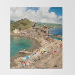 Sunbathing at the islet Throw Blanket