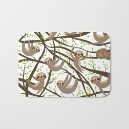 funny and cute smiling Three-toed sloth on green branch tree creeper Bath Mat