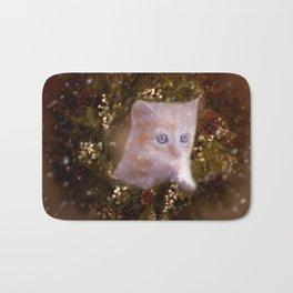 Christmas kitten watching the snow Bath Mat