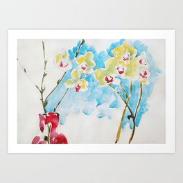 Yellow Orchids in Red Bottle Art Print
