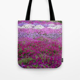 Waves of color on a sea of Petunias Tote Bag