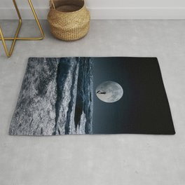 Kitesurfer in the moon in blue night sky horizon Rug