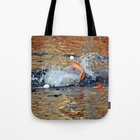 swimming Tote Bags featuring swimming by  Agostino Lo Coco