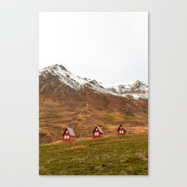 3 Red Cabins Canvas Print