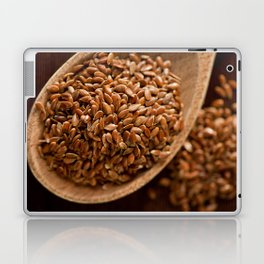 Brown flax seeds portion on wooden spoon Laptop & iPad Skin