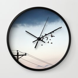 Geese over powerline Wall Clock