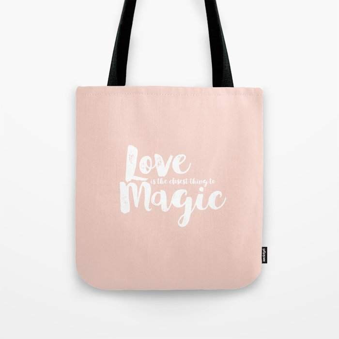 LOVE is the closest think to magic - Saying on peach background - on #Society6 Tote Bag