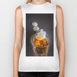 Whisky in glass lying on small rocks Biker Tank