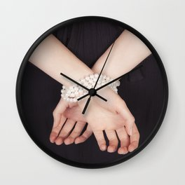 Tied with pearls Wall Clock