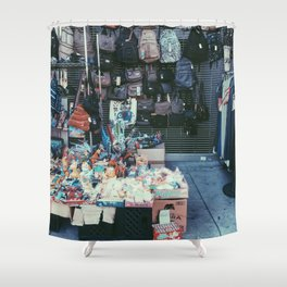 backpack and toy shop on the footpath Shower Curtain