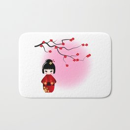 Japanese kokeshi doll at sakura blossoms Bath Mat