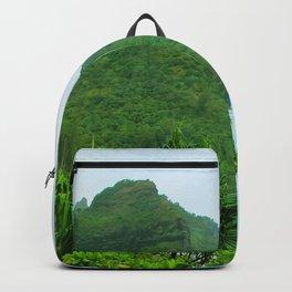 green mountain with blue ocean view at Kauai, Hawaii, USA Backpack