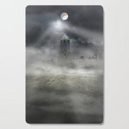 Foggy landscape with dark tower Cutting Board