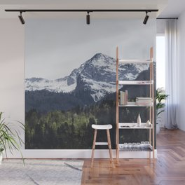 Winter and Spring - green trees and snowy mountains Wall Mural