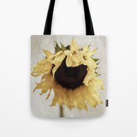 sunflower Tote Bags featuring sunflower by Bonnie Jakobsen-Martin