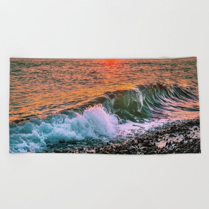 Sunset splash Beach Towel