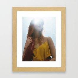 Woman in Light Framed Art Print