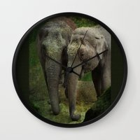 elephants Wall Clocks featuring Elephants  by Guna Andersone & Mario Raats - G&M Studi
