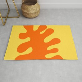 Orange coral on a yellow background Rug