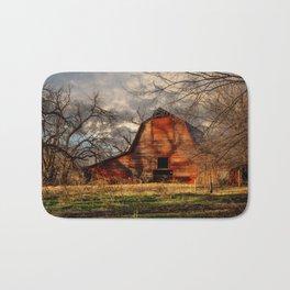 Red Barn - Rustic Barn in Shadows on Fall Day in Oklahoma Bath Mat