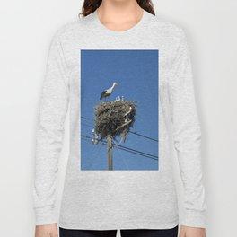 A stork family on a telegraph pole Long Sleeve T-shirt