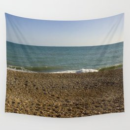 Evening Tide on a cobbled beach Wall Tapestry