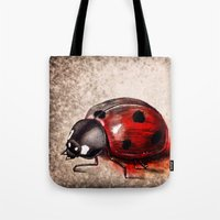 ladybug Tote Bags featuring Ladybug by Werk of Art