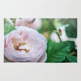 Busy bee in a rose garden Rug