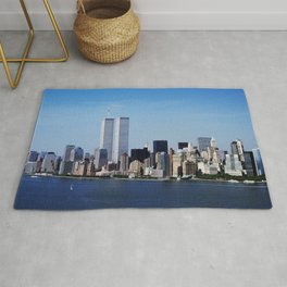 Aerial view of New York City in which the World Trade Center Twin Towers is prominent Rug