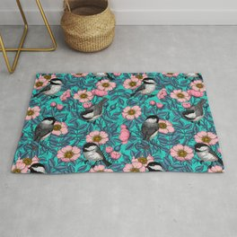 Chickadees in the wild rose, pink and blue Rug